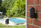 Canary Flex home security camera mounted on a brick wall outside
