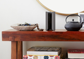 Graphite Canary View camera displayed on a wooden table beautifully matching design and elegance